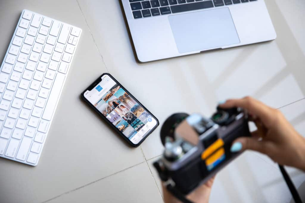 Camera, phone with photo gallery, keyboard and laptop