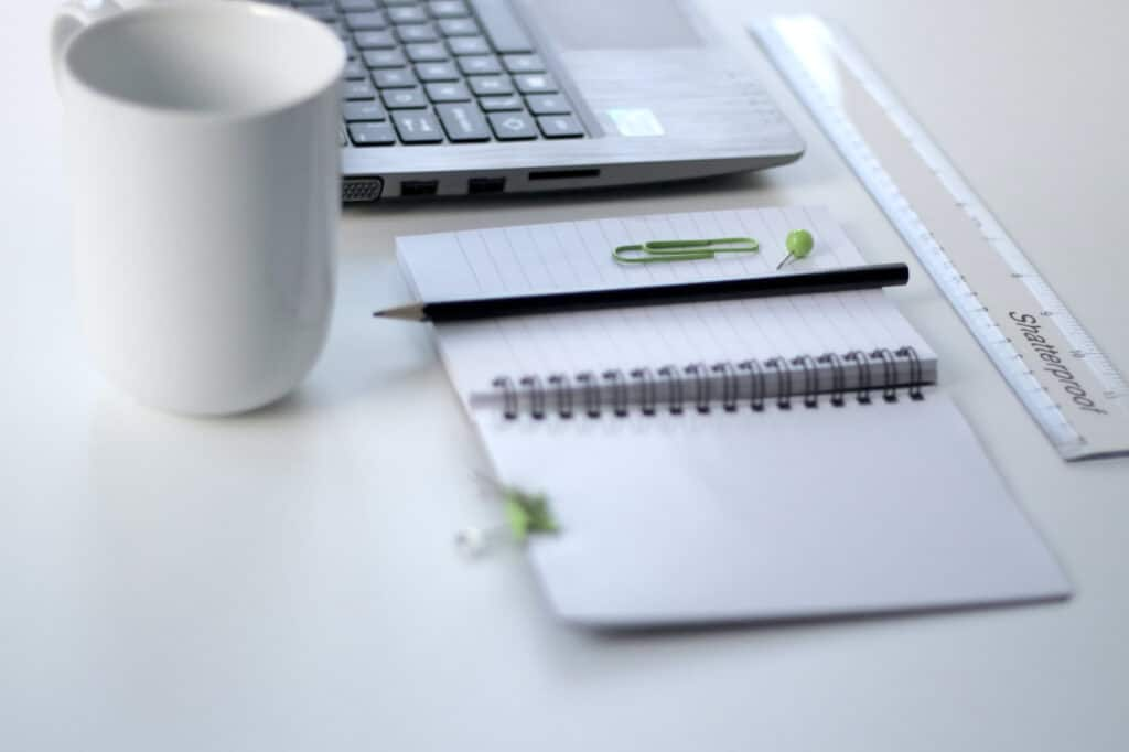 Notepad with green clips